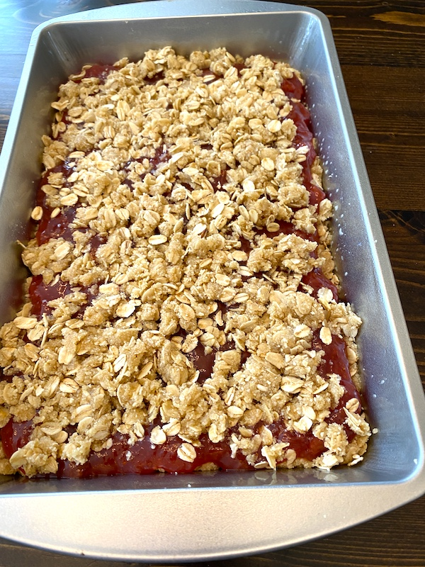 oatmeal mixture spread out over the top of the jam