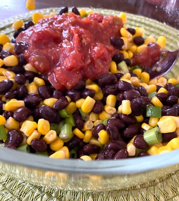 salsa added to the black bean, corn, and green onion mixture