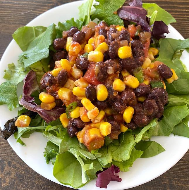 tex mex salad on a bed of mixed greens