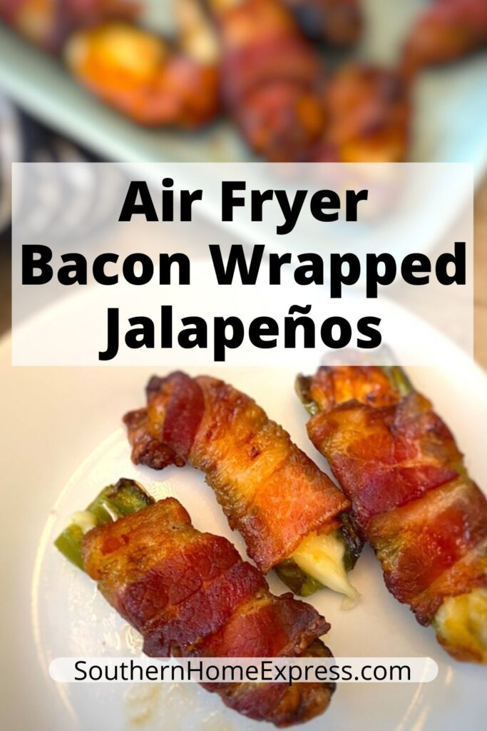 3 air fryer bacon wrapped jalapenos on a plate