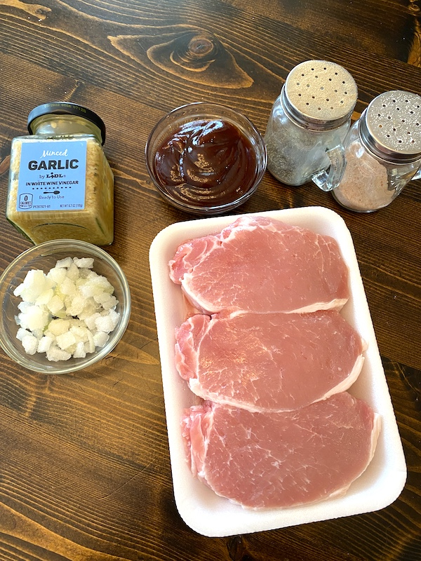 boneless pork chops, chopped onion, garlic, barbecue sauce, salt, and pepper