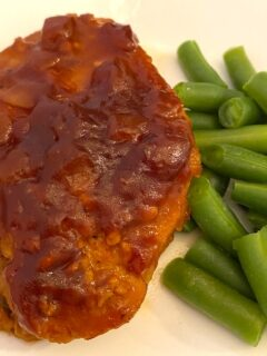 barbecue pork chop and green beans on a plate