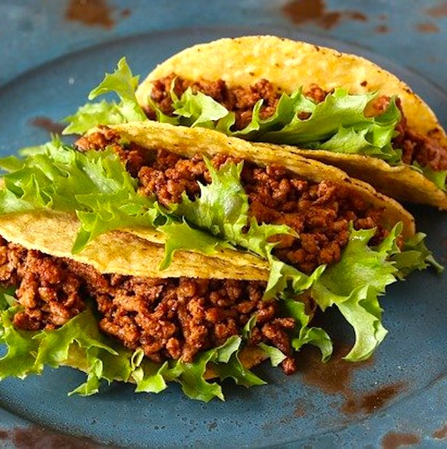 tacos filled with meat and lettuce
