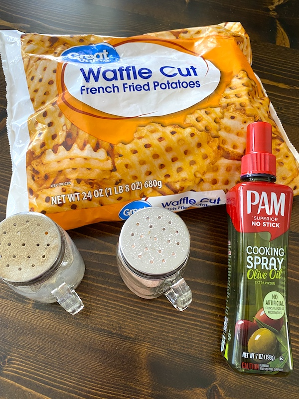 bag of frozen waffle fries, olive oil spray, salt, and pepper