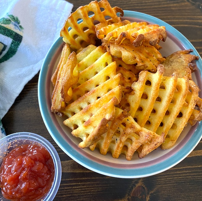 air fryer waffle fries with a side of ketchup