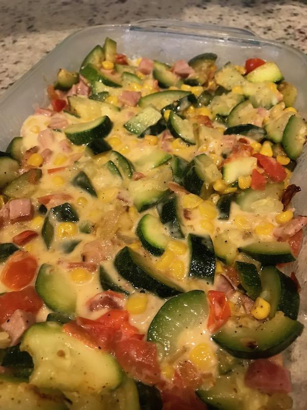 cheesy zucchini ham bake in a pan