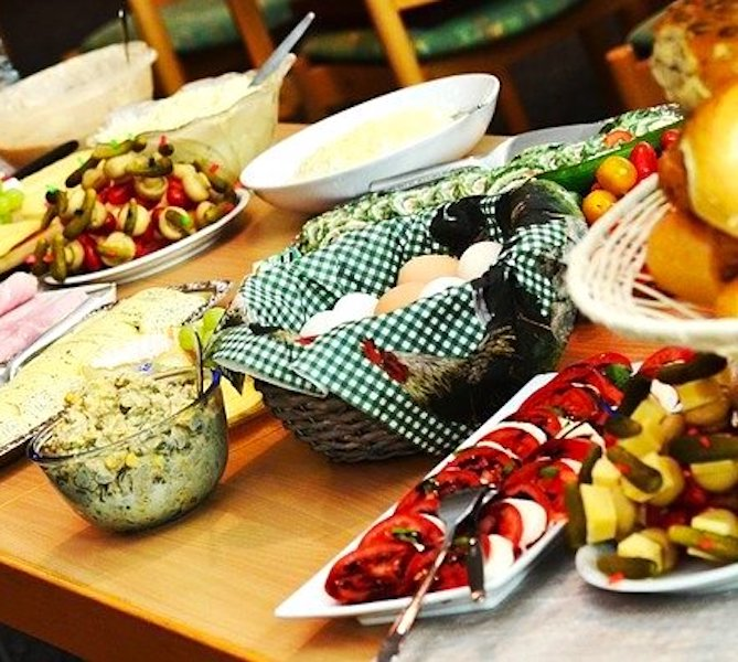 platters and bowls of food on a potluck buffet
