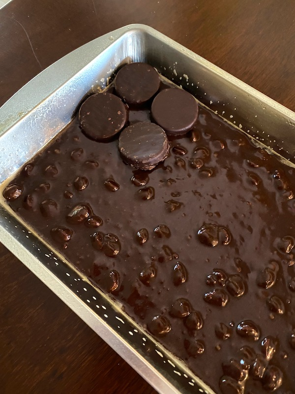peppermint patties placed on first layer of brownie batter